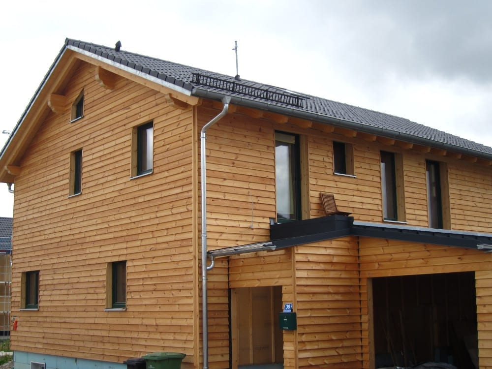 holzius Massivholzhaus Ergolding mit Carport